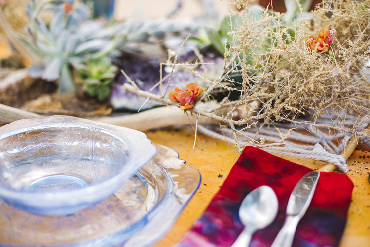 Wedding place setting with a beautiful centerpiece including a Mojave Macrame table runner